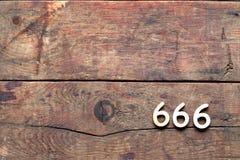 Número 666 na madeira Fotos de Stock Royalty Free