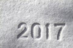 Número 2017 na superfície da neve Imagens de Stock Royalty Free