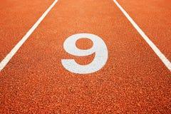 Número nove na pista de atletismo Fotografia de Stock Royalty Free