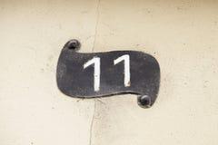 Número once en una pared Imagen de archivo