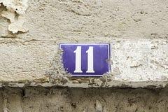 Número onze em uma parede Fotografia de Stock Royalty Free