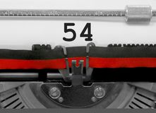 Número 54 pela máquina de escrever velha no Livro Branco Imagem de Stock