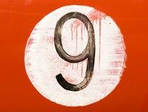 Número pintado en un coche viejo Imagenes de archivo