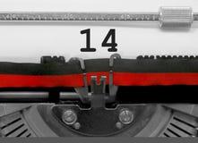 Número 14 por la máquina de escribir vieja en el Libro Blanco Imágenes de archivo libres de regalías