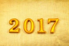 Número 2017 puesto en el fondo elegante del encanto del oro para nuevo YE Imágenes de archivo libres de regalías