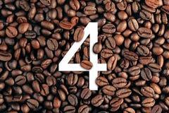 Número quatro no conceito do fundo do feijão de café Fotos de Stock Royalty Free