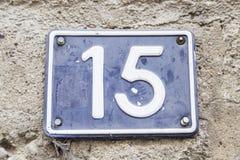 Número quince en una pared de una casa Foto de archivo libre de regalías