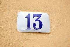Número trece en la pared de piedra Imágenes de archivo libres de regalías