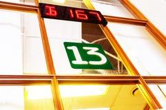 Número treze acima da janela da bilheteira fotos de stock royalty free