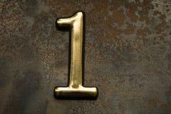 Número uno que pone letras Foto de archivo libre de regalías