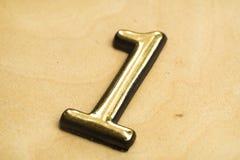 Número uno que pone letras Fotografía de archivo