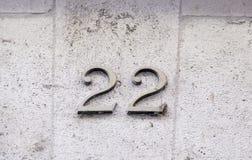 Número veintidós en una pared Fotos de archivo
