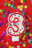 Número vela de tres cumpleaños Imagenes de archivo