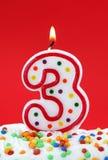 Número vela de tres cumpleaños Foto de archivo libre de regalías