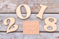 Número 2018 y Feliz Año Nuevo del mensaje Fotografía de archivo