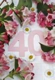 Número 40 y flores Imágenes de archivo libres de regalías
