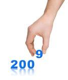 Números 2009 y mano Imagen de archivo libre de regalías