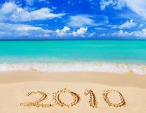 Números 2010 en la playa Imágenes de archivo libres de regalías