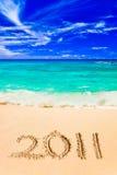 Números 2011 na praia Fotos de Stock Royalty Free