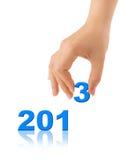 Números 2013 e mão Foto de Stock Royalty Free