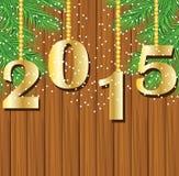 Números 2015 años en un fondo de madera con las ramas del ch Imagen de archivo