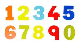 Números coloridos de madera en blanco Imagenes de archivo