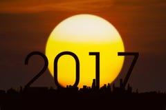 Números 2017 com um sol dourado Fotos de Stock Royalty Free