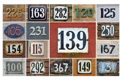 Números de casa 100+ Fotografia de Stock Royalty Free