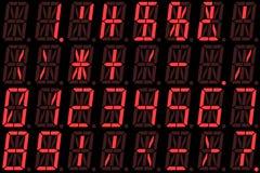 Números de Digitaces en pantalla LED alfanumérica roja Imagen de archivo libre de regalías