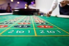 Números de la tabla verde del casino fotos de archivo