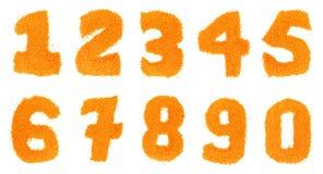 Números de lentejas en un fondo blanco Fotos de archivo