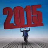 Números de levantamento 2015 do trabalhador novo Fotografia de Stock Royalty Free