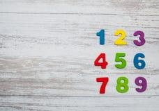 Números de madeira coloridos Imagens de Stock