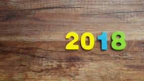 Números de madeira que formam o número 2018, pelo ano novo 2018 em um fundo de madeira Imagem de Stock Royalty Free