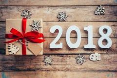 Números de madeira que formam o número 2018, pelo ano novo 2018 sobre Fotos de Stock