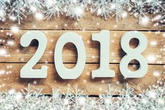 Números de madera que forman el número 2018, por el Año Nuevo y el whi Fotos de archivo libres de regalías