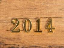 Números de oro 2014 en la madera Fotos de archivo libres de regalías