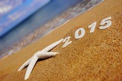 2015 números del Año Nuevo en la playa del mar Fotografía de archivo libre de regalías
