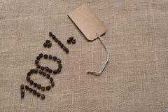 números del 100% de los granos y de la etiqueta de café Imagen de archivo