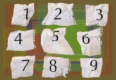 Números del papel de gráfico Fotos de archivo