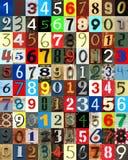 Números del periódico cortados como fondo fotos de archivo libres de regalías