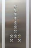 Números del suelo del elevador imagenes de archivo