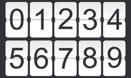 Números del tirón de Digitaces en fondo oscuro Foto de archivo libre de regalías