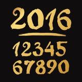 Números dibujados hechos a mano de oro 0-9 escrito con un cepillo Foto de archivo