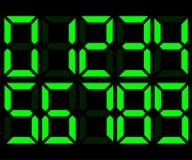 Números digitales electrónicos verdes Fotografía de archivo