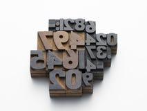 Números dos carácteres tipo na composição Imagens de Stock