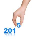 Números 2015 e mão Foto de Stock Royalty Free