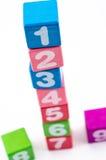Números em blocos de madeira coloridos Imagens de Stock