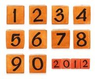 Números em cubos pintados de madeira Imagens de Stock Royalty Free