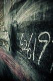 Números em um quadro-negro Fotos de Stock Royalty Free